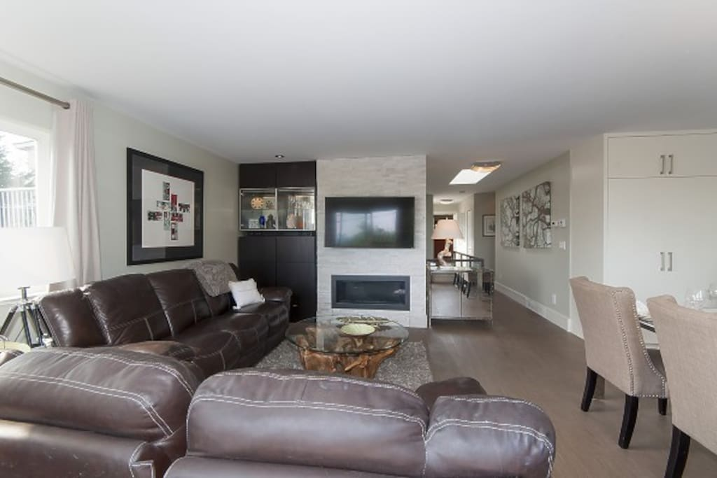 Living room with flat screen TV and gas fireplace.