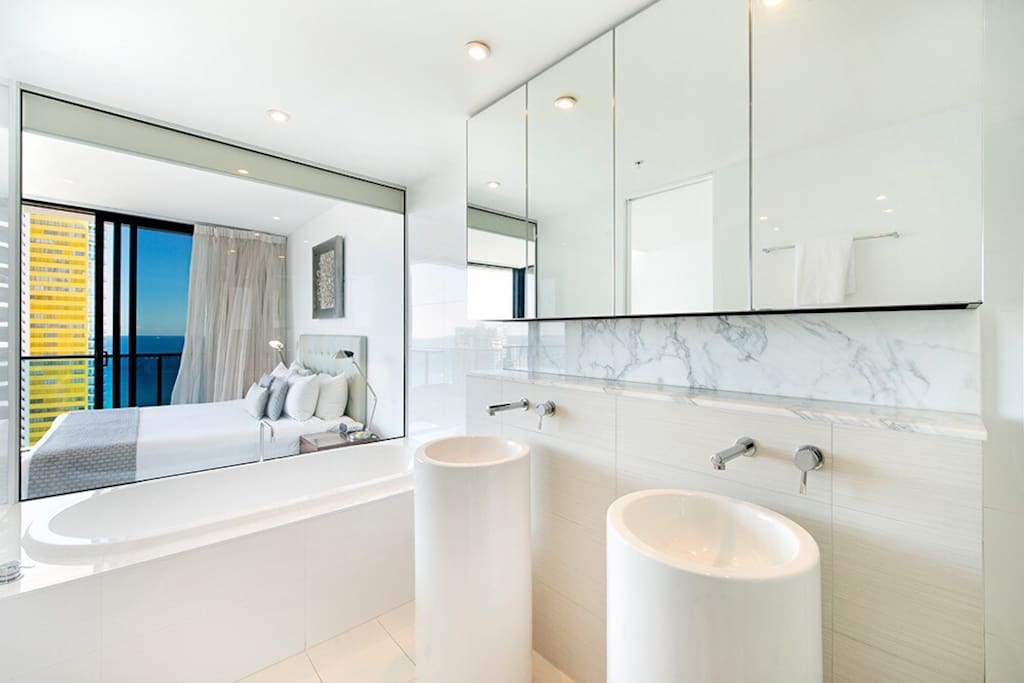 Enjoy the ocean from the bathtub in your private master ensuite ,equipped with two sinks, toilet ,bath and spacious shower.  Beautiful marble creates the elegance of a modern bathroom for the discerning guest. Plenty of storage behind the mirrors for your personal items. Hairdryer provided.