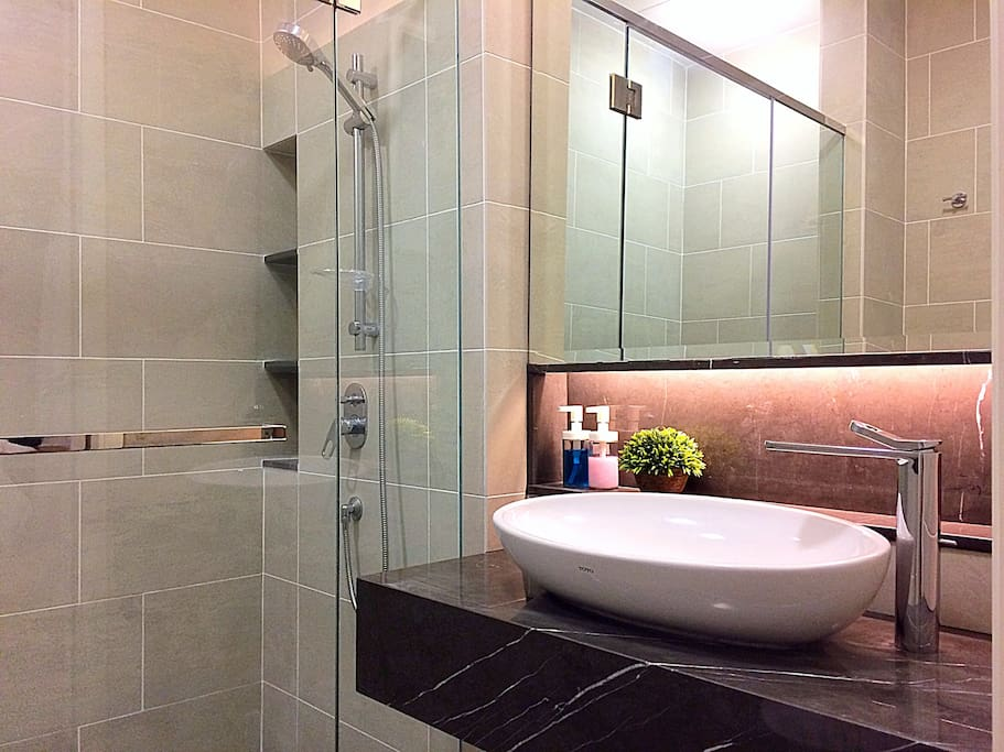 Bathroom with rainshower and water heater