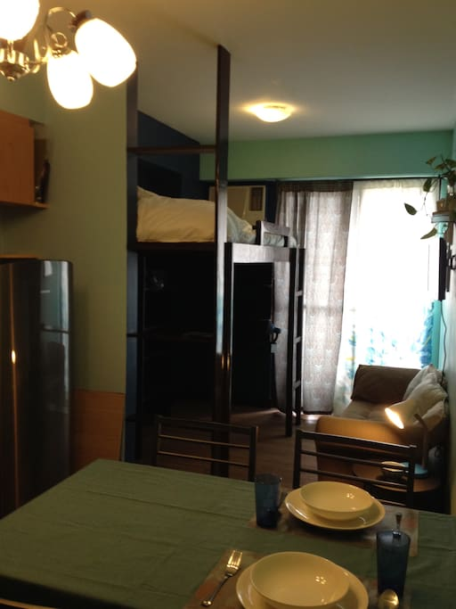 Elevated double bed with ample closet space below. Air conditioning available.