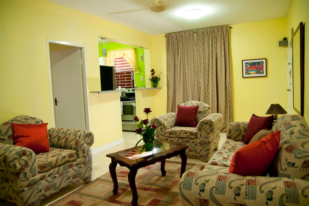 Spacious living room with comfortable sofas, Cable television, Wifi Internet.