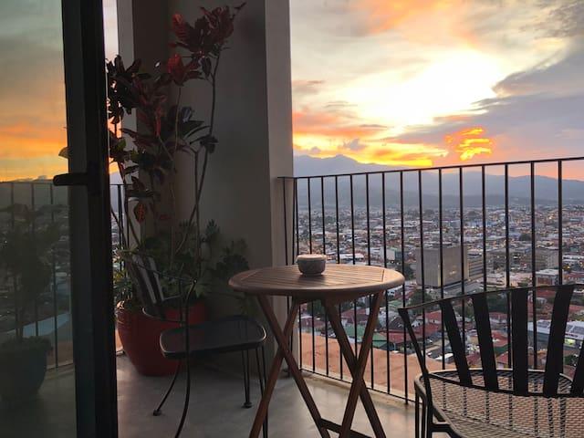 Charming apartment with corner balcony views