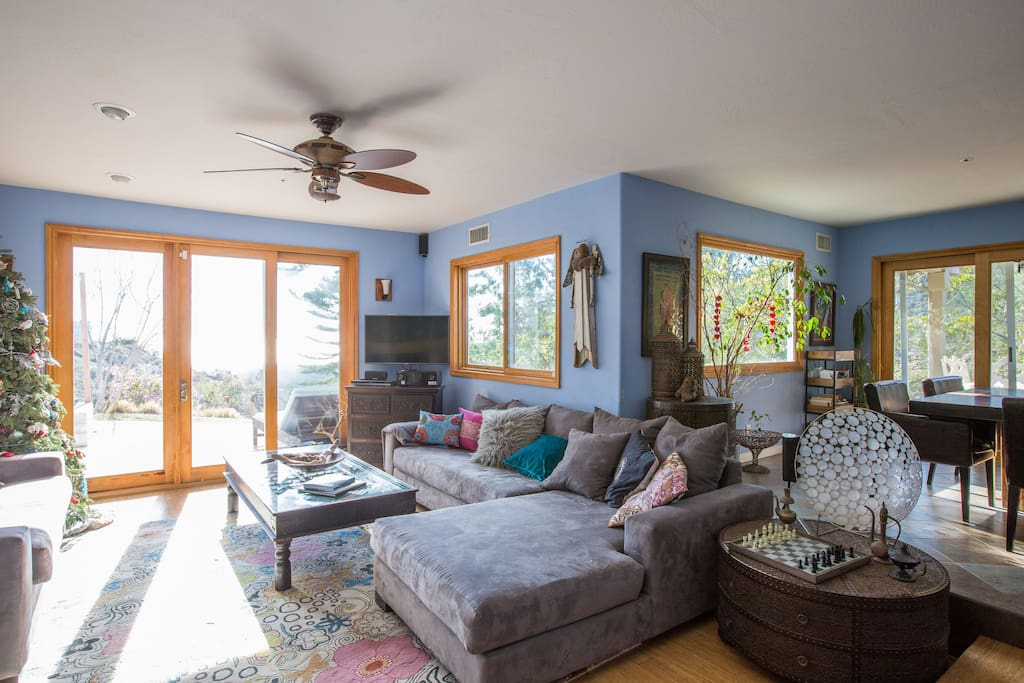 Living room is open to other areas of house creating spaciousness.