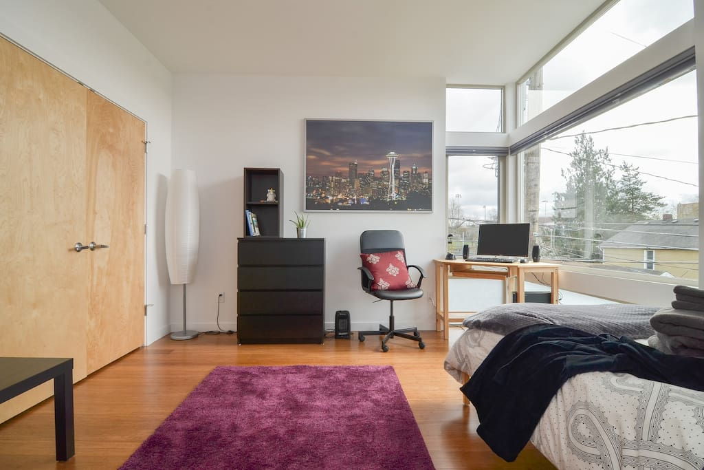 Large, modern room with workspace. Floor to ceiling windows! Sunshine pours into your private room. Tons of storage space: dresser and giant closet! We provide a cozy robe for your stay! As well as hangers, iron+board, extra linens, and a laundry bin. Free use of washer, dryer, and detergent!