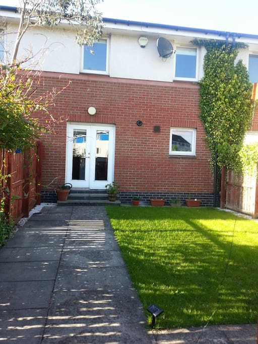 Mid terraced house with private garden, complete with garden furniture and bbq for sunny evenings