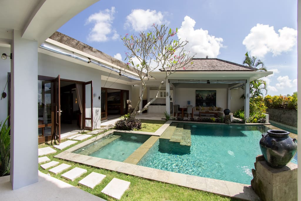 View on pool, bedroom, kitchen and living room.