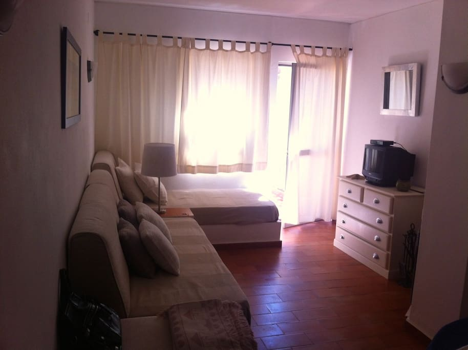 living room with 2 beds