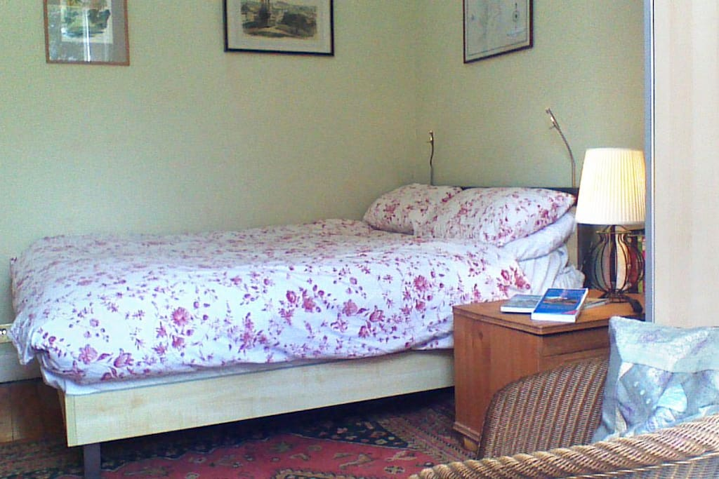 A bright, comfortable room with a good double bed.