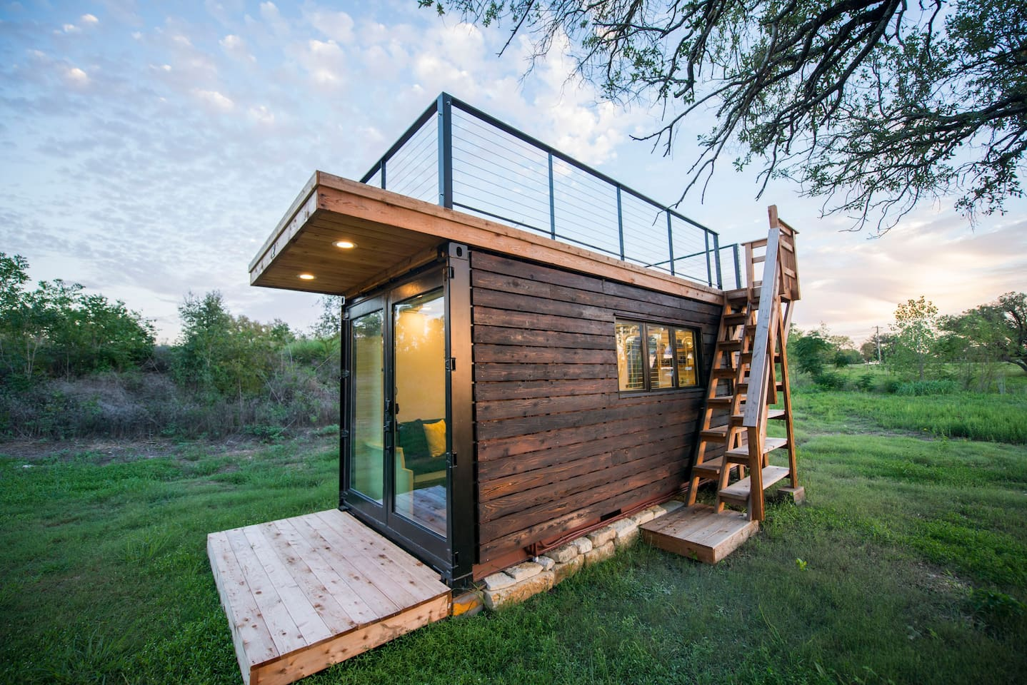 Our 20' container home clad in Shou Sugi Ban siding.