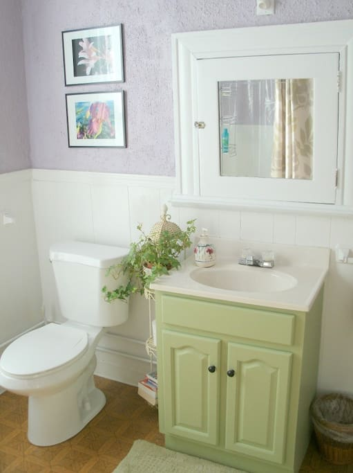 A claw foot tub and shower is available in the clean, bright bathroom.
