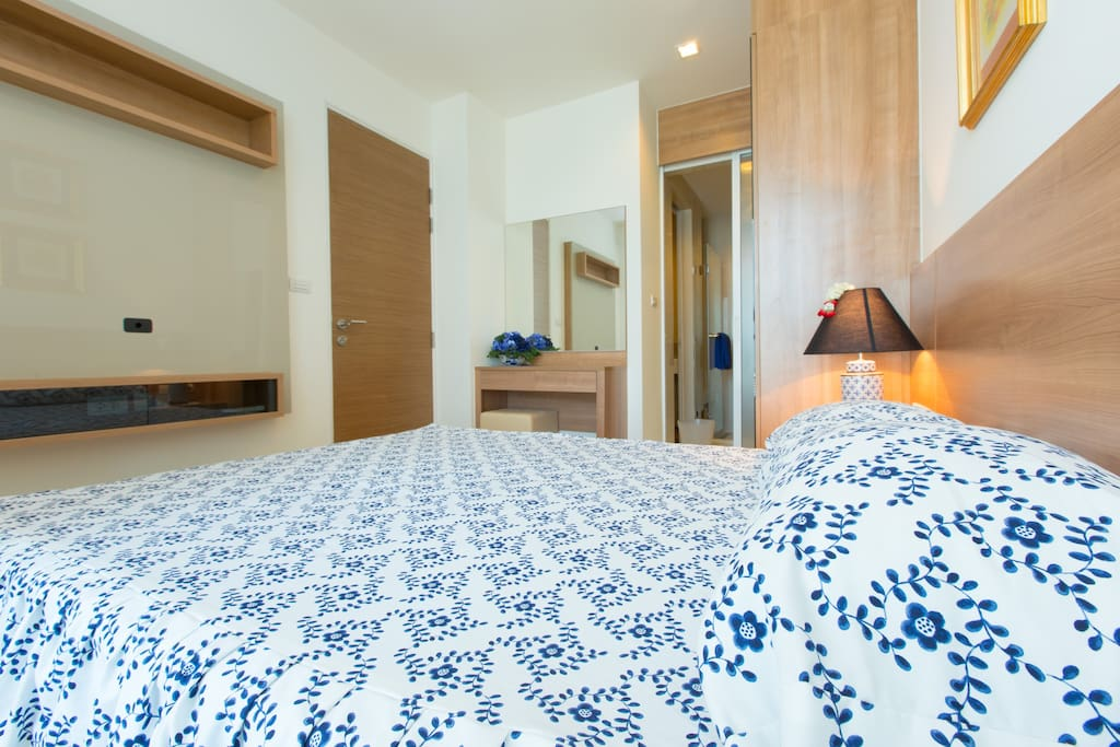 Bedroom with connecting bathroom door.
