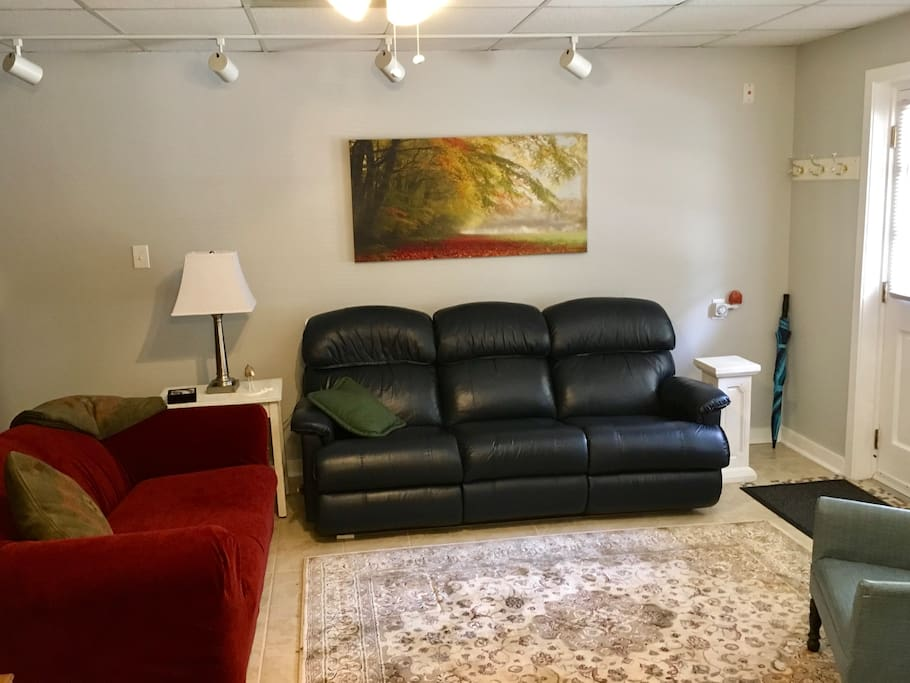 Very comfortable living room and the leather sofa is a double recliner