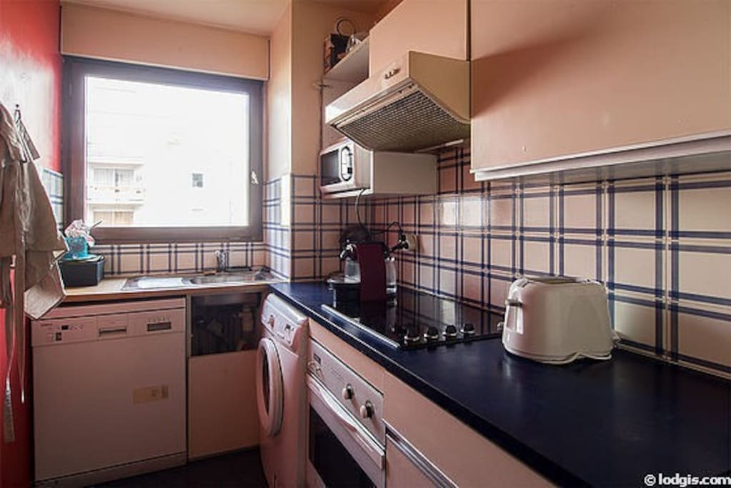 Kitchen furnished with washing machine