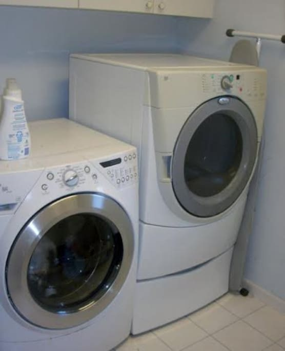 Complete laundry room with hanging rack, drying rack, and sink