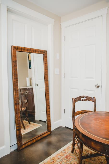 Full length mirror near closet and dining area