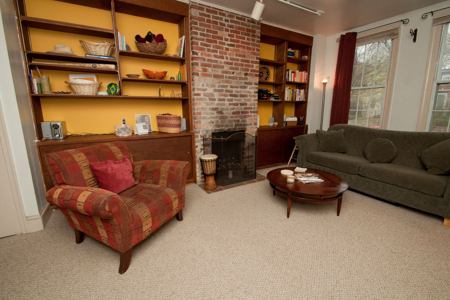 Cozy living room with exposed brick and comfy furniture for chillin' out.