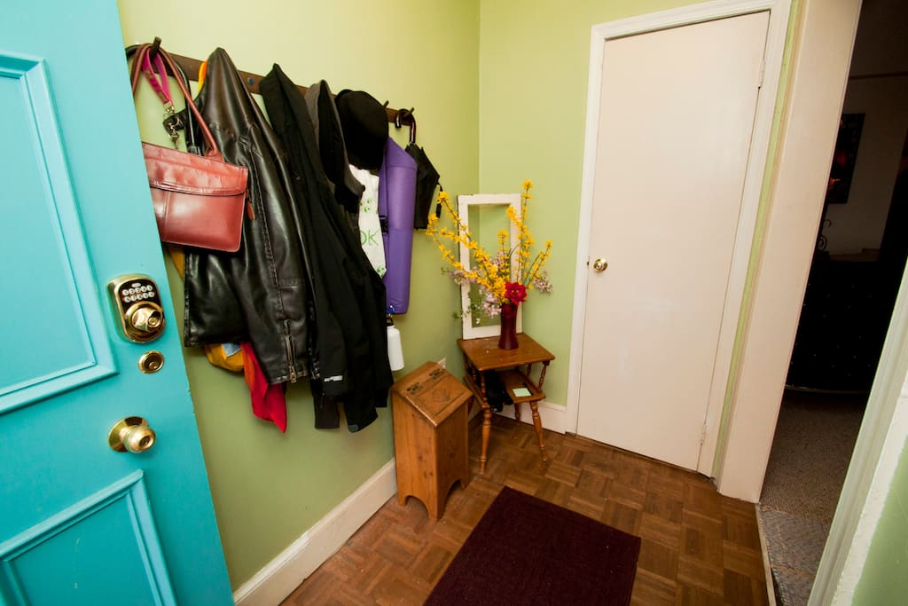 Entry way.  Modest guest bathroom door located here on first floor.   straight ahead.