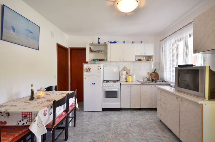 Kitchen and dining room are together.