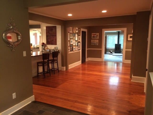 Entry way, leading to open kitchen, view into living room.