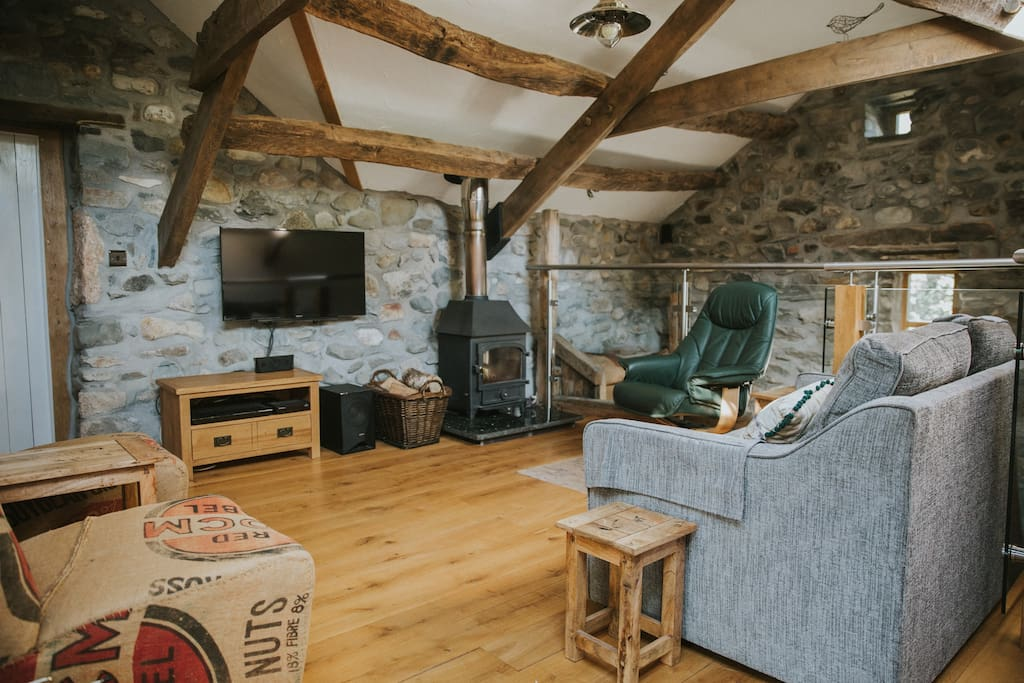 The lounge is upstairs with an oak floor, underfloor heating and a woodburner for added romance.