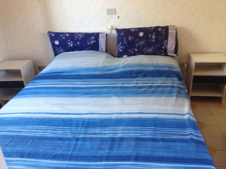bedroom with a double bed and a single bed