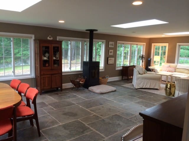 View of living and dining areas, woodstove.