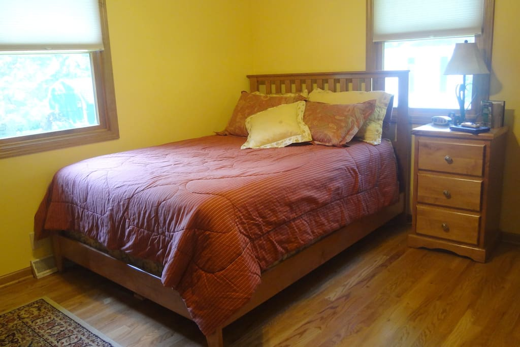 Guest Bedroom  Upper Level with Queen Size Bed, Dressers, Rocking Chair.