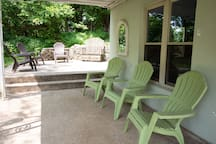 Ample outdoor seating to enjoy private wooded backyard.