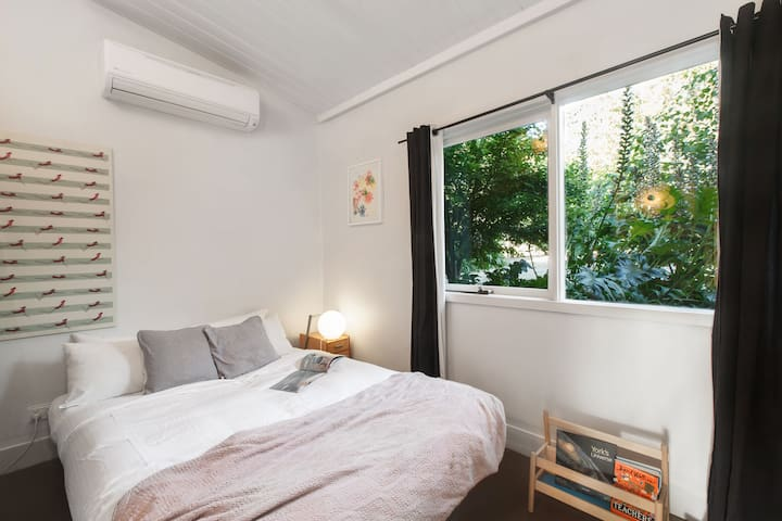 The second bedroom over looks the front courtyard and enjoys the most amazing morning sun.