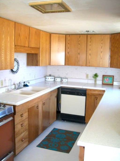 Good size kitchen area fully equiped with dishes, utensils and pots and pans, stove, refrigerator and dishwasher.
