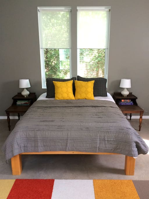 Super comfy queen sized bed with duvet and beautiful view onto private patio.