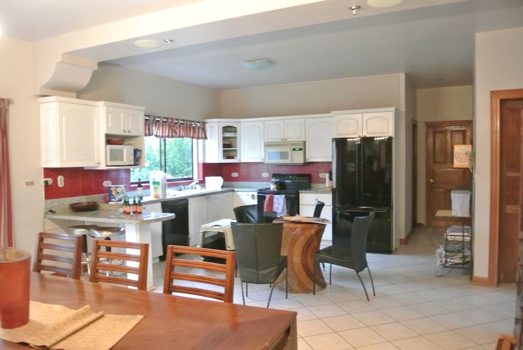 Modern kitchen with all appliances.  Our maid will cook you breakfast.
