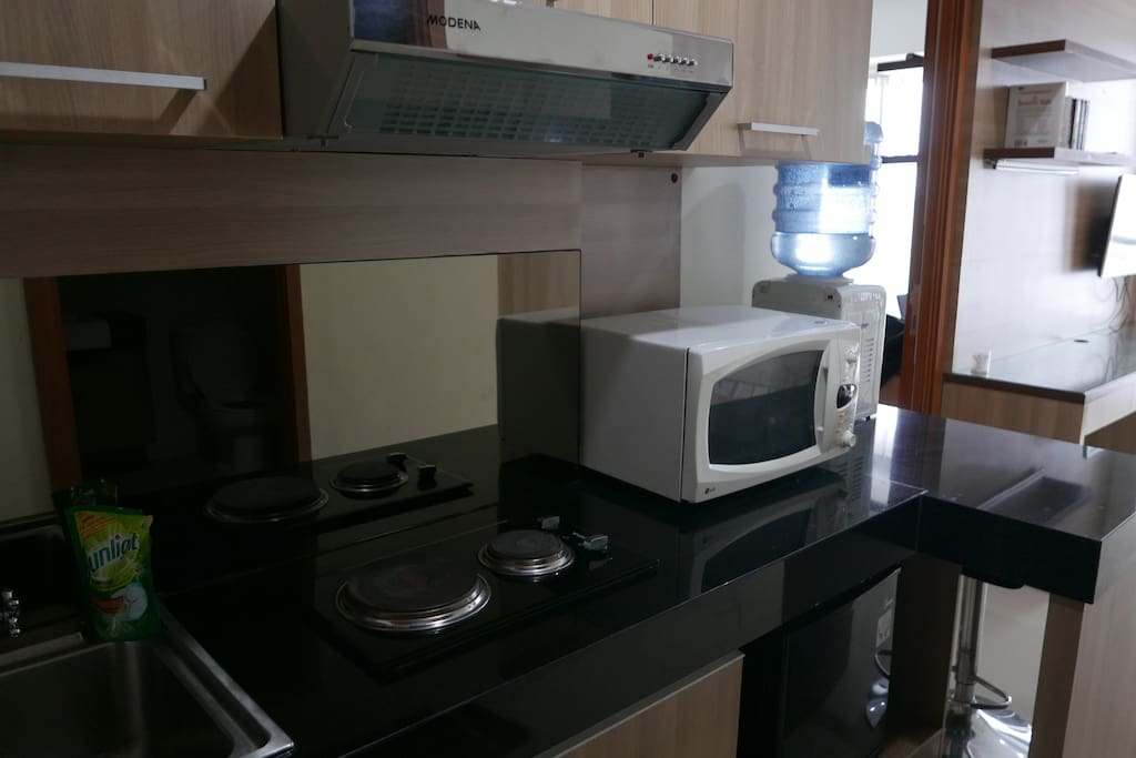 Small pantry - stove, microwave, mini fridge, eating utensils, sink.