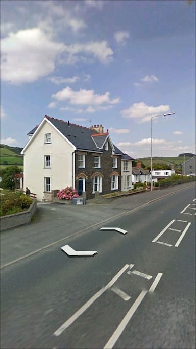 Street view pic. There is a newer purple brick wall along the pavement now.