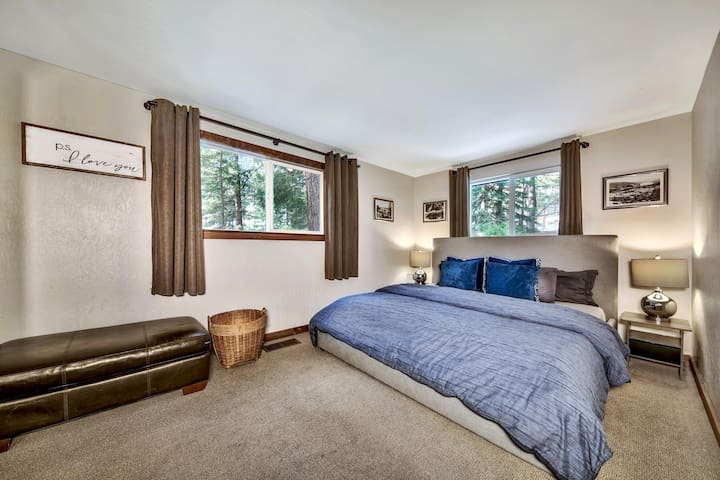 Cozy master bedroom with king bed, duvet, plenty of pillows, and the sound of a mountain stream right outside the window.  You may not want to leave.