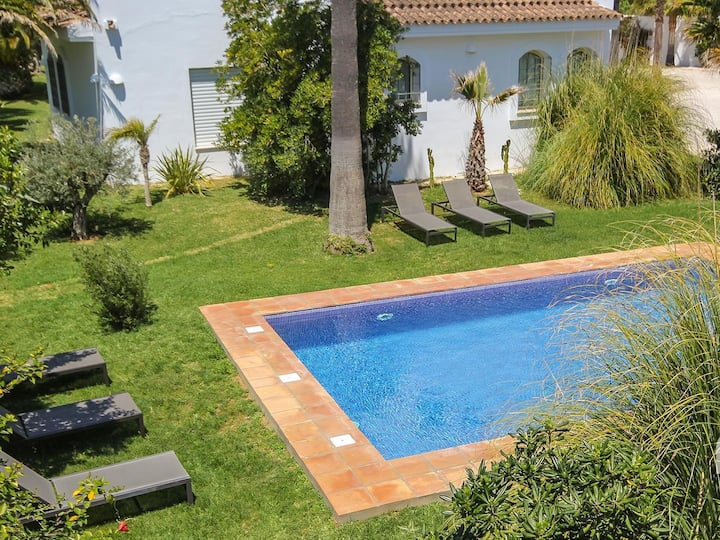 Luxury villa in Fuente del Gallo, very close to the sandy cove, shared pool.
