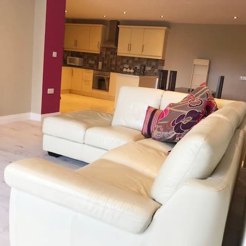 Our large corner sofa to relax after a day of exploring