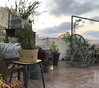 *Rooftop studio with sea view* (New Page)