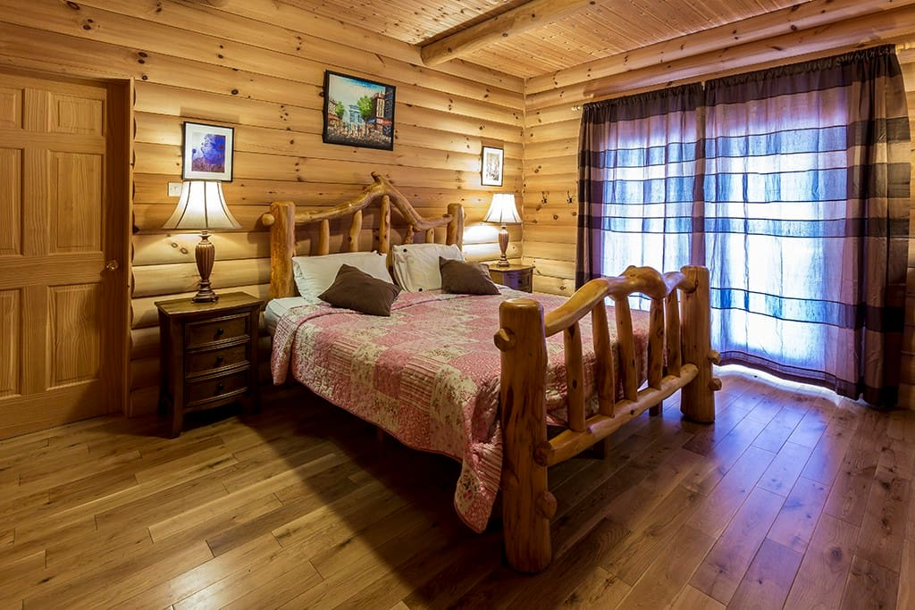 Bedroom 1:  handcrafted king size log bed.