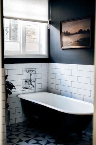 Cast iron claw foot bath tub and seperate shower with rainfall head