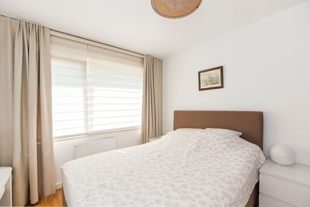 Comfortable double bad and sunlight bright room