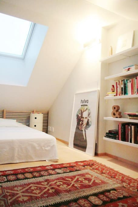 Main sleeping area on the loft with a double bed.