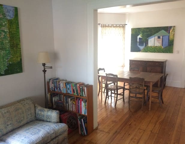Living and dining rooms. Wide selection of travel guides and odd ball books.