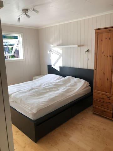 large bedroom with bathroom on the ground floor