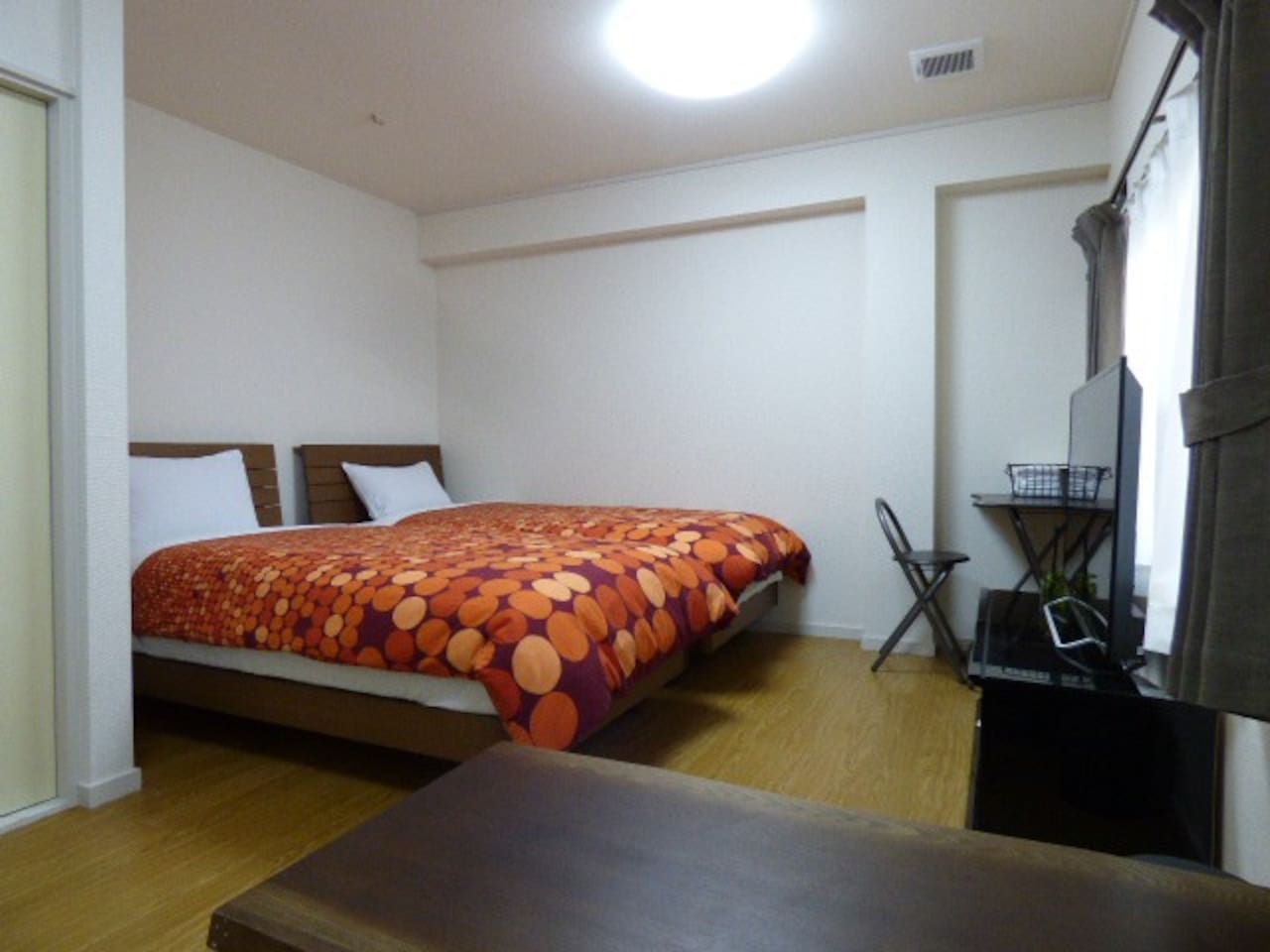 Triple room (2 single beds and 1 sofa bed)