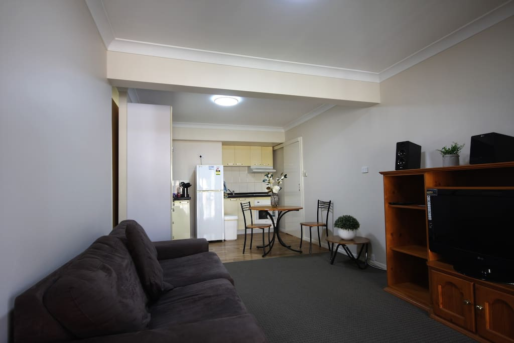 Robertson Airbnb Self Contained One Bedroom Unit view from the front entry into the open plan lounge/dining and kitchen area.