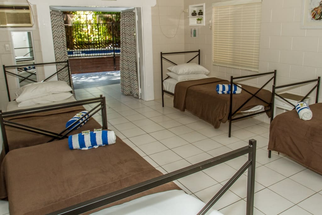 4 single beds with quality linen, towel and soap provided