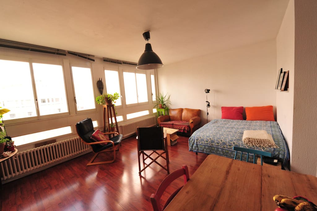 The living room with a double bed.