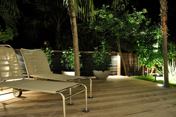The deck and garden by night