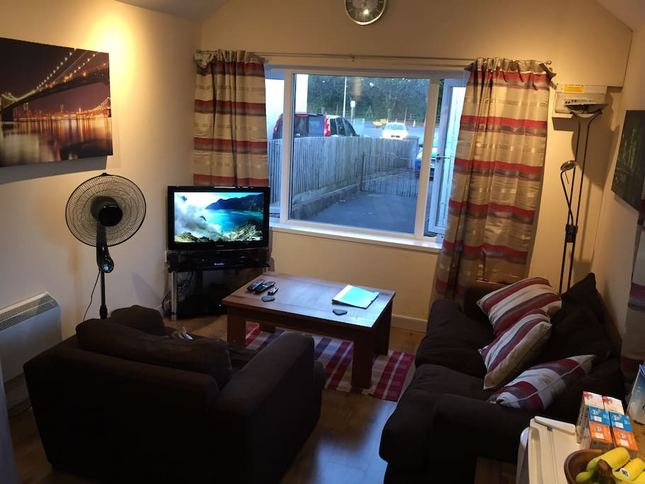 32'' LCD TV with surround sound and Freesat+ box. Very comfy armchair and sofa suite. There is a wall mounted heater (for cosy, curtains closed, cwtched up winters nights)!